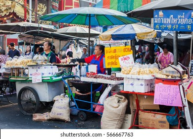 CHINATOWN, BANGKOK - 29 JAN, 2017: Street food vendor in front of Chinese temple or Wat Leng Noei Yi in Bangkok Chinatown.