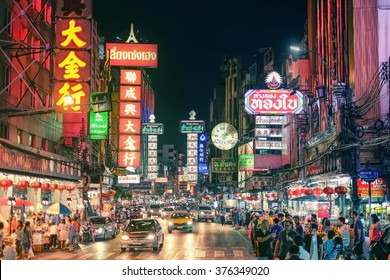 CHINATOWN, BANGKOK, THAILAND - 9 JANUARY, 2016: Cars and shops on Yaowarat road, the main street of China town.