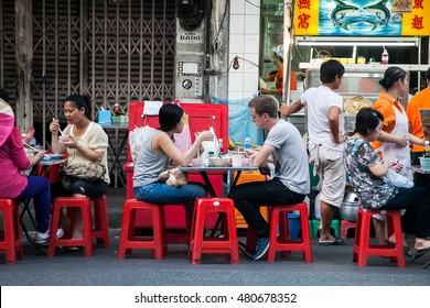 CHINATOWN, BANGKOK, THAILAND - 9 JANUARY, 2016: Tourist eating on the street food market in Yaowarat road, the main street of Chinatown in Bangkok. Chinatown is one of the famous landmark in Bangkok.