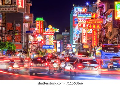 CHINATOWN, BANGKOK, THAILAND - AUG 25 , 2017: Cars and shops on Yaowarat road. Chinatown with notable Chinese buildings, restaurants and decoration. Busy Yaowarat Road in the evening. chinese new year