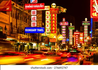 CHINATOWN, BANGKOK, THAILAND - CIRCA MAY, 2015:  Cars and shops on Yaowarat road, the main street of China town.