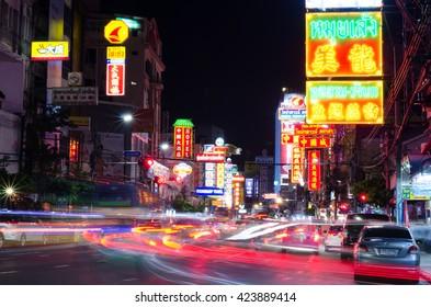 CHINATOWN, BANGKOK, THAILAND - CIRCA MAY, 2016: Cars and shops on Yaowarat road, the main street of China town.
