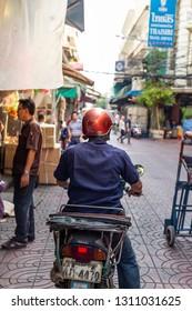 CHINATOWN, BANGKOK, THAILAND - Feb 2, 2019: Cars and shops on Yaowarat road, the main street of China town
