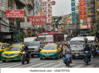 CHINATOWN, BANGKOK, THAILAND - MAY 28, 2019: Cars and shops on Yaowarat road. Chinatown with notable Chinese buildings, restaurants and decoration. Busy Yaowarat Road, Bangkok, Thailand