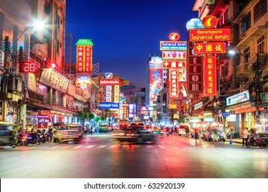CHINATOWN, BANGKOK, THAILAND - MAY 3 , 2017: Cars and shops on Yaowarat road. Chinatown with notable Chinese buildings, restaurants and decoration. Busy Yaowarat Road in the evening. chinese new year
