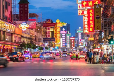 CHINATOWN, BANGKOK, THAILAND - SEP 4 , 2018: Cars and shops on Yaowarat road. Chinatown with notable Chinese buildings, restaurants and decoration. Busy Yaowarat Road in the evening. chinese new
