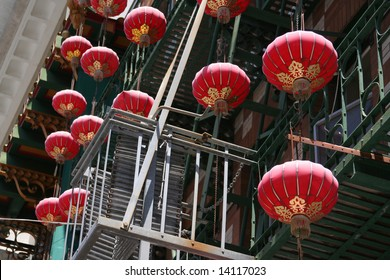 CHINATOWN CHINESE LANTERN Red and gold Chinese lanterns hanging from a building in San Francisco Chinatown