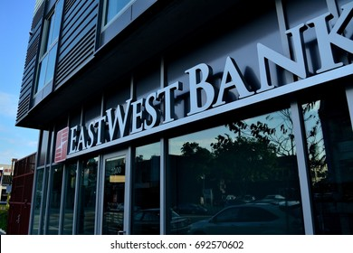 Chinatown, Los Angeles - August 2017: An East West Bank sign hangs above a new branch in Chinatown in a mixed use building
