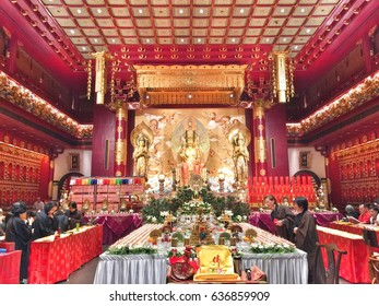 Chinatown, Singapore - April 23, 2017 : Buddhists perform religious rituals inside the temple