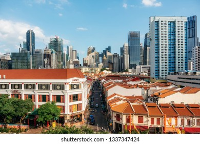 Chinatown, Singapore - February 8, 2019: Aerial view of Chinatown with red roofs and Central Business District against blue sky