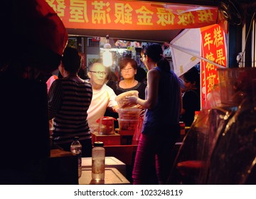 Chinatown, Singapore - January 31, 2018 : Unidentified shoppers buy traditional cookies for the upcoming Chinese New Year at China Town, Singapore on January 31, 2018 .