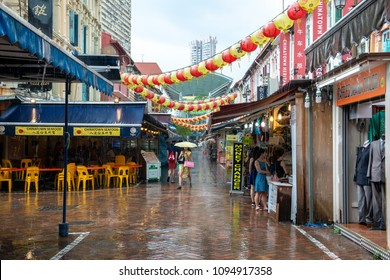 CHINATOWN, SINGAPORE, MARCH 25,2017 : Rainy day of Bustling street of Chinatown in Singapore. Singapore's Chinatown is a world famous bargain shopping destination.