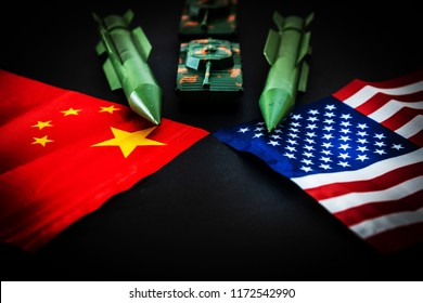 China-US trade war concept - Military facilities on the flag of China and the United States
