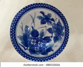 chinaware ceramic, old bowl porcelain decorated with  blue and white pigments, cobalt oxide, drawing flowers or patterns