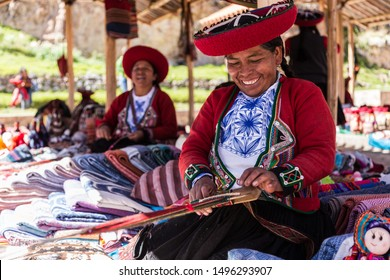 CHINCHERO, CUSCO, PERU - 05, 19, 2019: Andean women knitting a belt at Chinchero craft market. For this kind of knit, uses wool  natural hand dyed whit  natural dyes.
