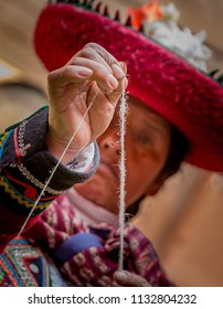 CHINCHERO, PERU- MAY 2018- Peruvian woman checks the strength of