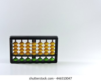 Chinese abacus calculation board isolated on white