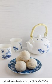 Chinese ancient dessert called 'Pia' or Mung bean filling cake, Chinese pastry or moon cake on dish and teapot set, Traditional delicious cake in asia.