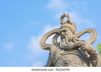 Chinese Ancient god Guan Gong Guan Yu statue day time,suphanburi Province  Thailand.