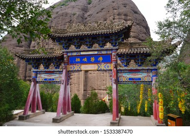 Chinese ancient traditional archway in Tianshui Wushan Water Curtain Caves, Gansu China. Chinese translation : Buddhism