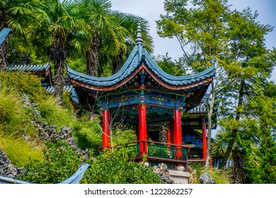 """Chinese arbor it is traditional Chinese architecture. Mu's Residence (Mufu Mansion). Located in Old Town of Lijiang, Yunnan Province, China. Translation is """"Arbor of Peace""""."""