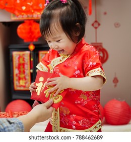 Chinese baby girl  traditional dressing up get  a FU means lucky red envelope
