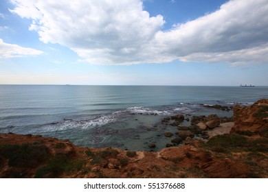 The Chinese Bay, a beautiful shoreline near Hadera, Israel. With cliffs and rocks falling into the water.