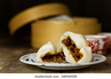 Chinese BBQ Pork Buns served on enamel plate