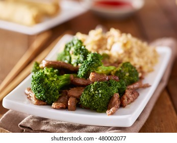 chinese beef and broccoli stir fry with fried rice