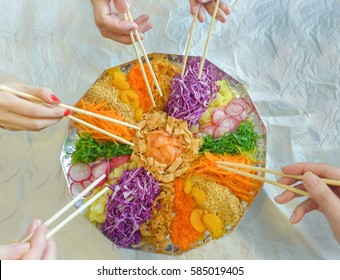 """Chinese belief,eating """"yee sang""""(raw fish toss)during Chinese New Year brings good luck and prosperity / Fusion prosperity toss / Healthy fusion raw fish salad toss with all natural fresh ingredients"""
