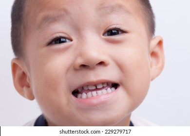 A Chinese boy closeup isolated on white background.