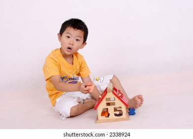 Chinese boy playing with toy