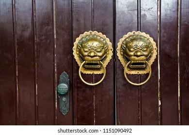 Chinese brass lion sculpture of texture background  wood door