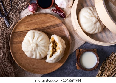 Chinese breakfast: Steamed buns (Baozi), and soy milk. Flat lay, overhead top view