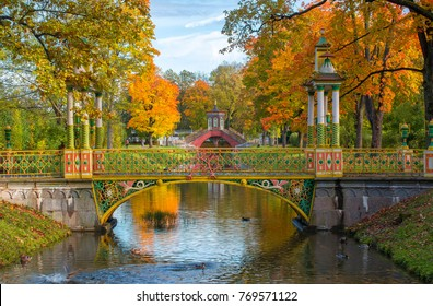 Chinese bridge in Alexander park in golden fall, Pushkin, Saint Petersburg, Russia