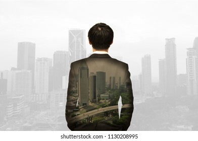 A Chinese business man in suit with building background in urbanization concept for modern world who set vision and mission to set direction and strategy for making revenue and profit for company