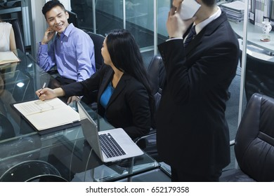 Chinese business people talking in meeting