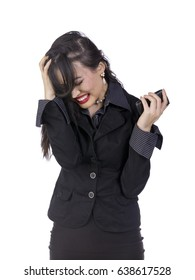 Chinese business woman in stylish black business suit dress showing frustration and anger while talking on mobile phone isolated on white background