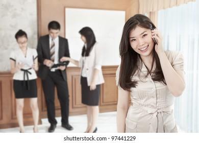 Chinese businesswoman is on the phone in the office
