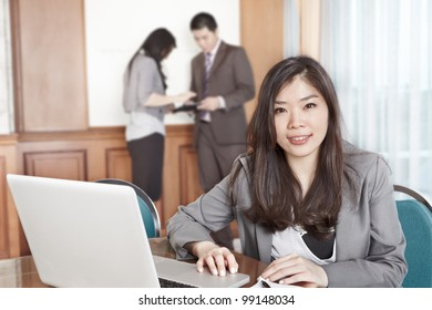 Chinese businesswoman smiling to the camera in the office