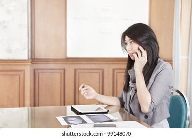 Chinese businesswoman is talking on the phone