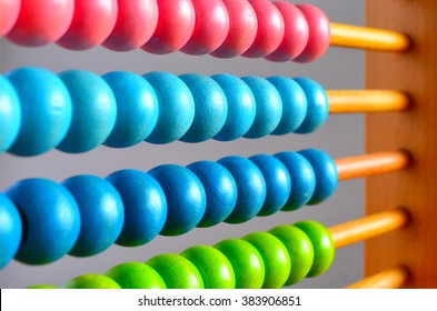 Chinese calculator with colorful beads - Close-up. Concept photo of business, child ,education , teaching ,learning, teaching, mathematics, arithmetic, accounting, calculate and calculating skills.