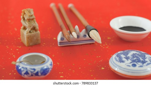 Chinese calligraphy writing tool on red paper
