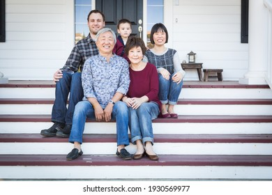 Chinese and Caucasian Family Sitting on Front Porch. - Shutterstock ID 1930569977
