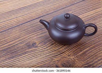 Chinese ceramic tea set on wooden table