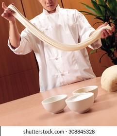 Chinese chef making fresh noodles