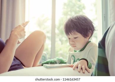 chinese child addicted phone, asian girl playing smartphone, kid use telephone, watching smartphone, watching cartoon