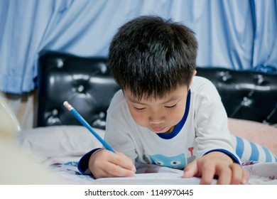 chinese children writing paper with pencil, boy doing homework