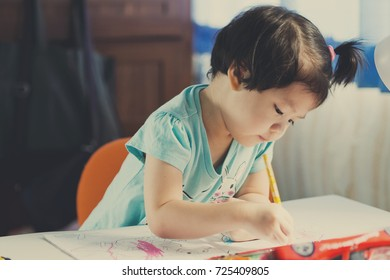 chinese children writing paper with pencil / kid doing homework