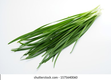 Chinese chives. Garlic chives on white background.